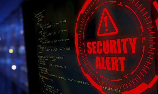 Security alert sign on computer alerting you to online fraud
