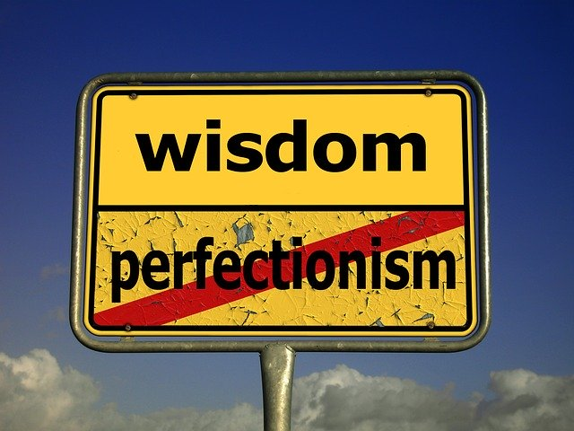 Sign that shows wisdom is better than perfectionism